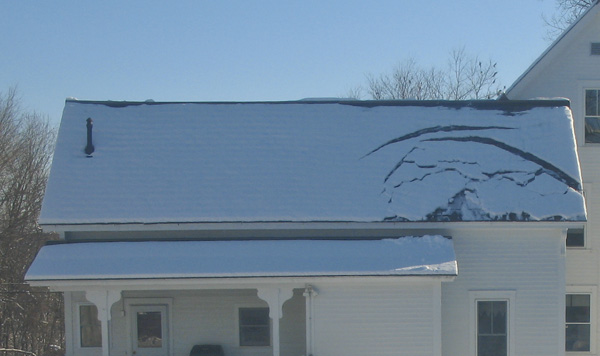 Snowmelt pattern on half the roof